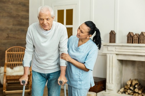 Nurse helping Resident